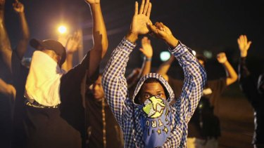 Demonstrators protestg the shooting death of Michael Williams.