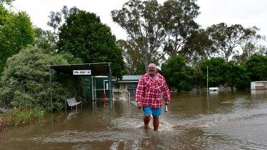 A man walks through flood water in Euroa.