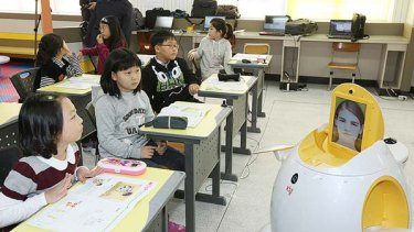 "English-teaching robot ""Engkey"" stands in front of children at an elementary school in Daegu, 240 kms southeast of Seoul."