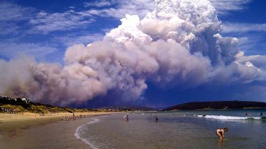 A fire at Forcett, 30km from Hobart, sends smoke over Park Beach. At nearby Carlton River residents were being told to evacuate.