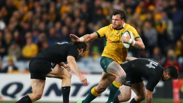 Adam Ashley-Cooper takes on the defence during the Rugby Championship match between the  Wallabies and the All Blacks at ANZ Stadium.