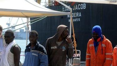 Asylum-seekers in Palermo harbour last week.