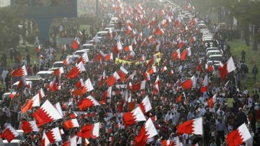 Shi'ite Bahrainis march in an anti-government demonstration towards Pearl Square in Manama.