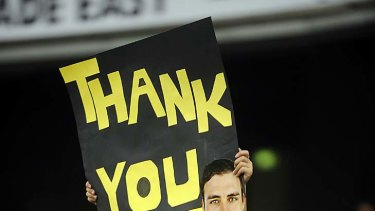 Giving thanks: The Tigers' faithful show their feelings to a favourite son.