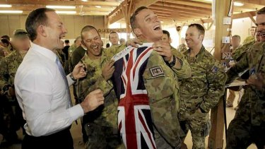 Abbott meets with troops.