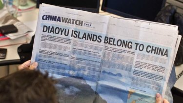 A double page advertisement regarding the territorial dispute between China and Japan over the uninhabited group of islands in the East China Sea - known as the Senkaku in Japan and Diaoyu in China.