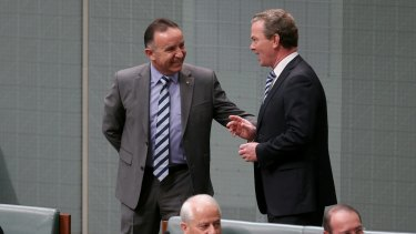 Government whip Andrew Nikolic speaks with Leader of the House Christopher Pyne during question time on Monday.