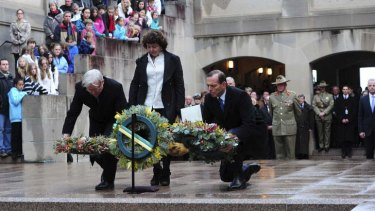 Prime Minister Kevin Rudd his wife Therese Rein and Opposition leader Tony Abbott laying wreaths during the last post ceremony. Photo: Melissa Adams