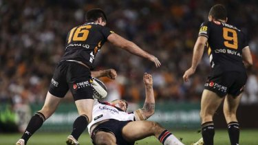'That' hit  ... Wests Tigers' Simon Dwyer flattened Roosters enforcer Jared Waerea-Hargreaves with a monster tackle