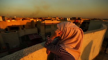 A female internally displaced person (IDP) from Fallujah on a rooftop overlooking Baghdad.
