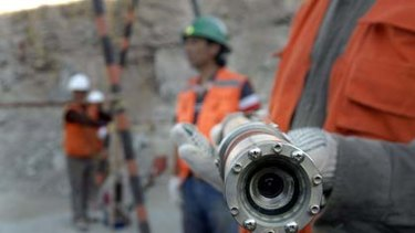 Watching the trapped miners ... this video camera is sent down a 700m shaft.