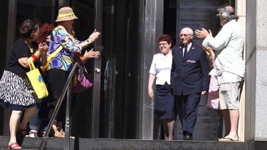 Whistleblower: Salvation Army major Cliff Randall is applauded as he leaves the royal commission after giving evidence about the church's Indooroopilly boys' home.