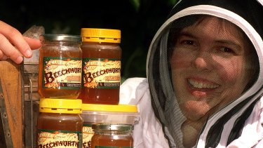 Beechworth Honey owner Jodie Goldsworthy with some of her produce.