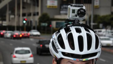 Silent witness ... a cyclist with a camera attached to his helmet.