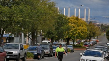 A local worker crosses the road in the Morwell town center. Photo: Eddie Jim