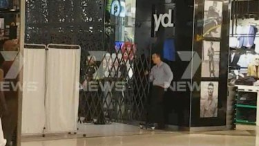 Police have cordoned off part of the shopping centre, including Yd. clothing.
