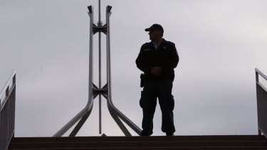 Lockdown: An Australian Federal Police officer at the ministerial entrance to Parliament House.