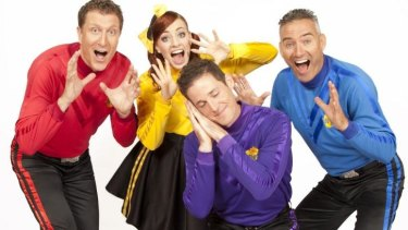 Lachlan 'Lachy' Gillespie, the purple Wiggle, and Emma Watkins, the yellow Wiggle, with Simon Pryce (in red) and Anthony Field (in blue).