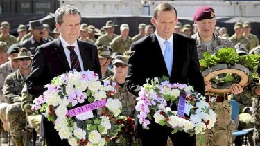 Tony Abbott and Bill Shorten laying wreaths during the Recognition Ceremony in Tarin Kowt.