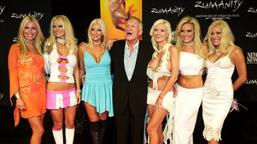 Hugh Hefner with his, then, six girlfriends in 2003: (L-R) Sheila Levell, Izabella St. James, Zoe Gregory, Holly Madison, Bridget Marquardt and Cristal Camden.