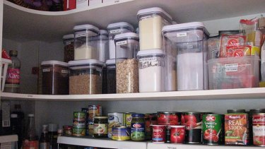 Pantry makeover ... Karen Koedding puts plastic containers, internal shelves and labels to good use for a client.