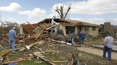 Residents search through what is left of their homes after a tornado hits Pleasant Grove.