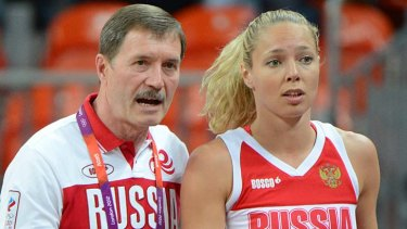 """Terrible game"" ... Russian coach Boris Sokolovskiy chats to Russian forward Ilona Korstin."
