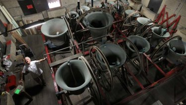 Striking: Gordon Cannon rings the bells at St Mary's Cathedral.