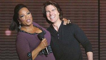 Tom Cruise on stage with Oprah Winfrey.