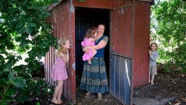 School's in: Annie Regan home schools her children Caitlin, 9, Liam, 7, and Millie, 4, at their Tarrawarra  home.