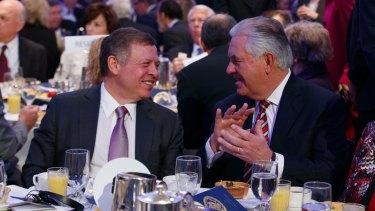 Jordan's King Abdullah, left, talks with US Secretary of State Rex Tillerson during the National Prayer Breakfast, on Thursday.