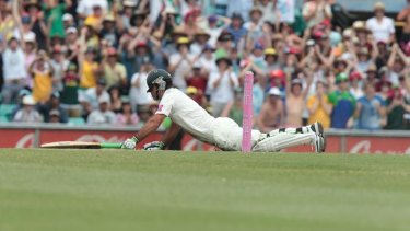 Down but not out ... Ricky Ponting dives to make his ground to score his first Test century in nearly two years.