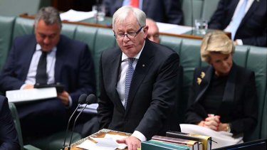 Prime Minister Tony Abbott has announced Trade minister Andrew Robb, pictured during question time on Monday, has cancelled a planned trade visit to Russia.