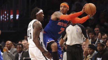 Under the microscope: New York forward Carmelo Anthony looks to pass while Gerald Wallace of the Brooklyn Nets tries to prevent his opponent dishing off.