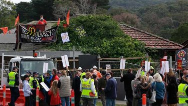 Local residents in Tecoma protest against a McDonald's restaurant being built in the area.