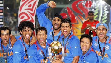 India's players celebrate with the trophy.
