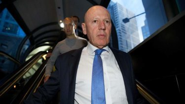 Verbal battle: Chris Hartcher departs the ICAC on Monday, followed by his son.