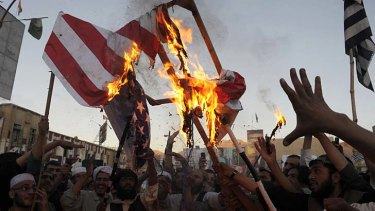 Angry: Pakistani Muslim demonstrators burn a US flag in Quetta to protest against an anti-Islam film that has been circulating on YouTube.