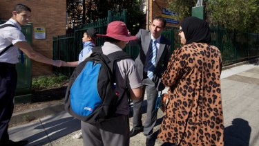 Meet and greet ... Dib waits at the school gates every morning and welcomes each boy by name.