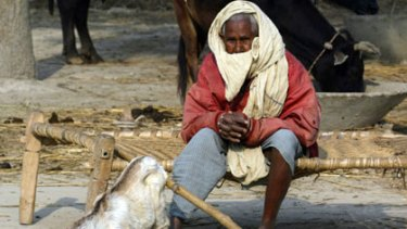 """A Dalit (""""untouchable"""") man sits on the outskirts of the city of Lucknow."""