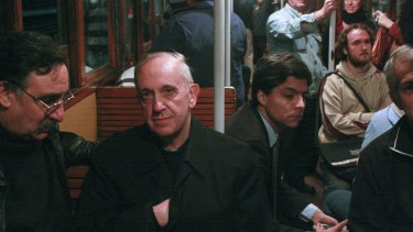 In this 2008 photo, the new Pope Jorge Mario Bergoglio, second from left, travels on public transport in Buenos Aires, Argentina.