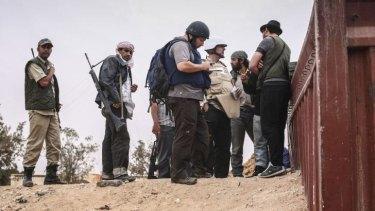 US reporter Steven Sotloff (centre) at work in Libya in 2011.