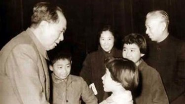 The good old days ... Mao Zedong shakes hands while the young Liu Yuan (immediately right of Mao) looks on, with his parents and sisters.
