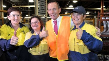Opposition Leader Tony Abbott at the Ford factory in Geelong in 2011. While highlighting the carbon tax, he admitted there were 'a whole range of factors' behind the decision to close the plant.