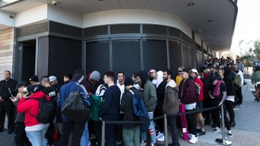 Kanye West fans line up for the opening of his pop up clothing store in Bondi, Sydney. The queues started forming at 6 pm the night before the 10 am opening, with many people paying others to sleep in line for them.