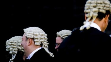 Premier Campbell Newman has accused bikie lawyers of being hired guns.