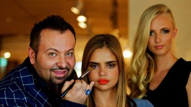 Brush with fame ... Napoleon Perdis puts the finishing touches on model Samantha Harris's make-up. Perdis says  his products are  for the woman on the street as well as the runway.