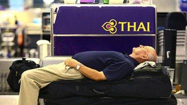 A European tourist sleeps at Suvarnabhumi airport, Bangkok in the early hours of Wednesday Nov. 26, 2008.