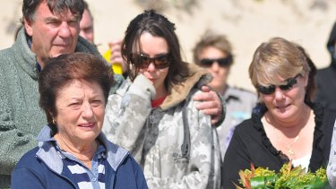 Kyle's grandmother (front, left) and mother Sharon (far right) at the memorial paddle-out at Bunker Bay this morning.