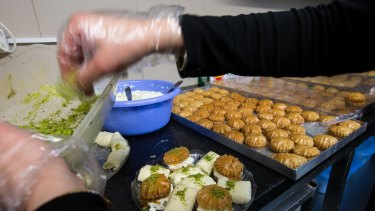 Abdul Neeman, owner of Sweets Palace, prepares sweets for Ramadan.